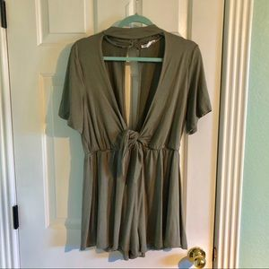 Low cut front romper never worn